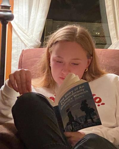 Maddy engrossed in The Diary of An Extraordinarily Ordinary Woman!